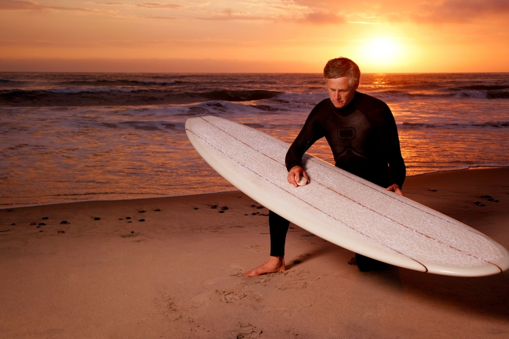 Why do surfers wax their boards
