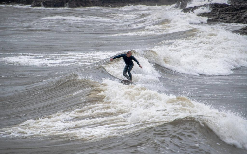experienced-surfer-in-porthcawl-rest-bay